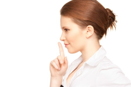 bright picture of teenage girl with finger on lips Stock Photo - 7497235