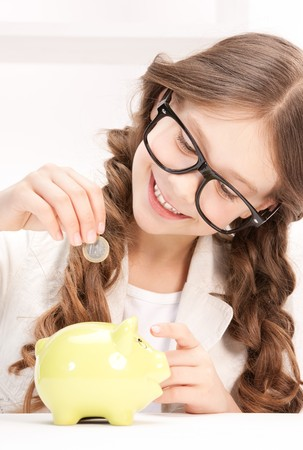 picture of little girl with piggy bank and coin photo