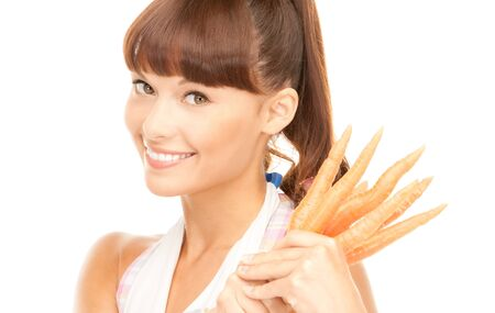 bright picture of beautiful housewife with carrots over white photo