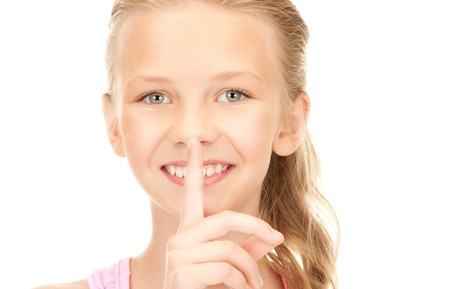 bright picture of pretty girl with finger on lips  photo