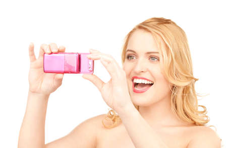 picture of happy woman using phone camera Stock Photo - 7533465