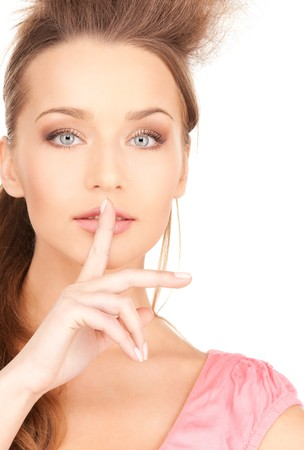 bright picture of young woman with finger on lips Stock Photo - 7533872