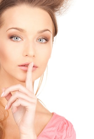 bright picture of young woman with finger on lips Stock Photo - 7527599