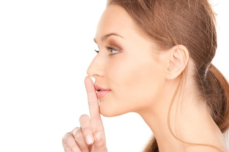 bright picture of young woman with finger on lips Stock Photo - 7527588