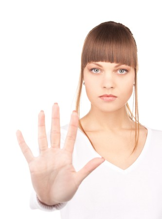 bright picture of young woman making stop gesture Stock Photo - 7527594