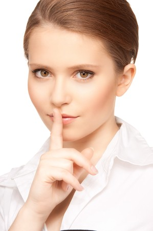 bright picture of teenage girl with finger on lips