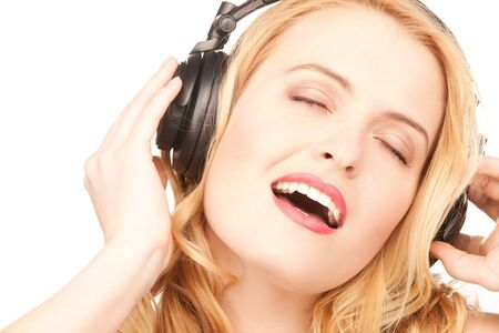 picture of happy woman in headphones over white Stock Photo - 7555239