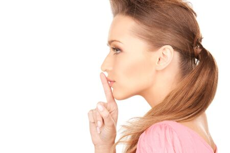 bright picture of young woman with finger on lips Stock Photo - 7555203