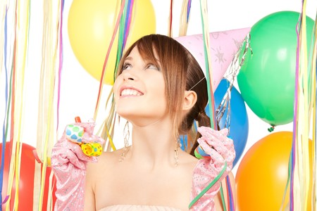 happy teenage party girl with balloons over white photo