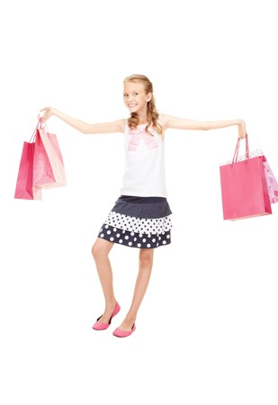 carrying girl: happy girl with shopping bags over white