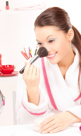 picture of lovely woman with brush and mirror photo