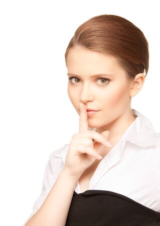 bright picture of teenage girl with finger on lips Stock Photo - 7636505