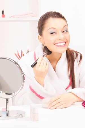 powder room: picture of lovely woman with brush and mirror