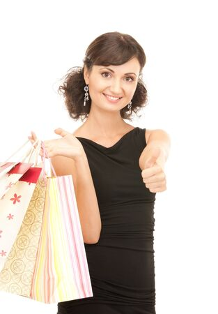 lovely woman with shopping bags over white Stock Photo - 7686375