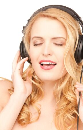 picture of happy woman in headphones over white Stock Photo - 7686384