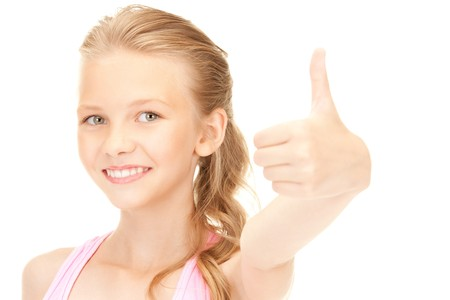 bright picture of lovely girl showing thumbs up sign Stock Photo - 7686568