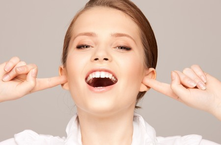 picture of woman with fingers in ears Stock Photo - 7686569