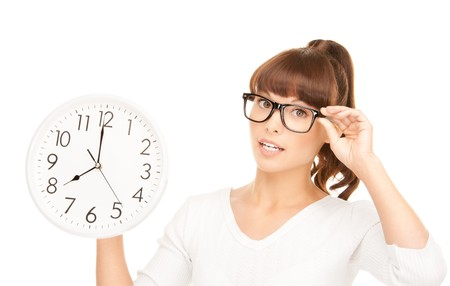 picture of woman holding big clock over white Stock Photo - 7686543