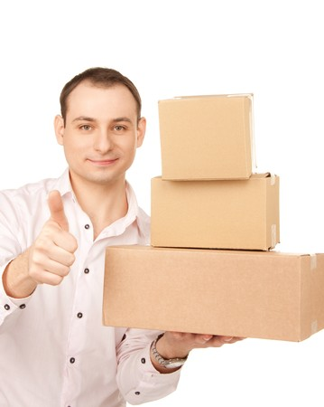 picture of businessman with parcels over white Stock Photo - 7795675