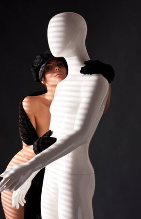 nude male: picture of naked woman with white male mannequin Stock Photo