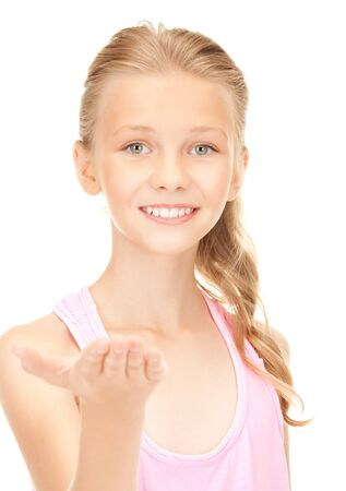 preteen girls: lovely girl holding something on the palm of her hand