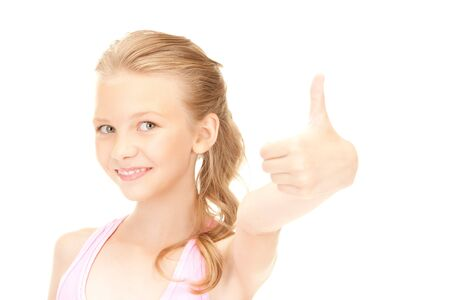 bright picture of lovely girl showing thumbs up sign Stock Photo - 7812274