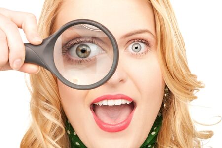 picture of woman with magnifying glass over white Stock Photo - 7812532