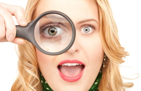 picture of woman with magnifying glass over white photo