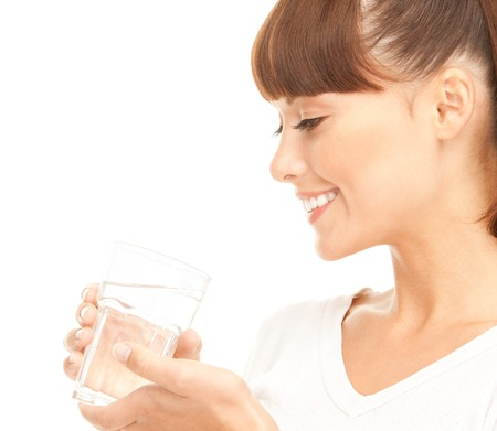 beautiful woman with glass of water over white photo
