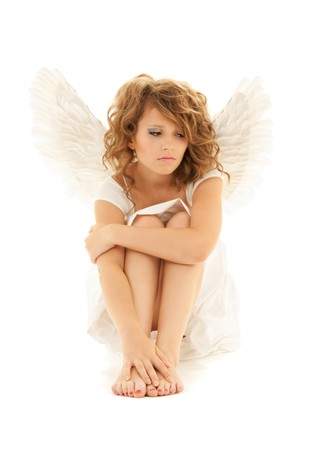 angel alone: picture of unhappy teenage angel girl over white