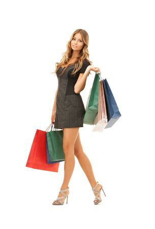 lovely woman with shopping bags over white Stock Photo - 7885851