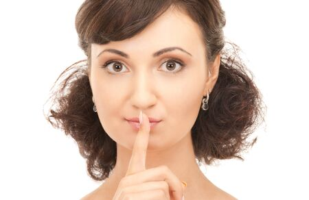 bright picture of young woman with finger on lips Stock Photo - 7885879