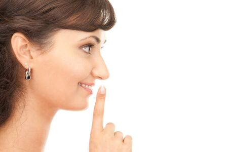 bright picture of young woman with finger on lips Stock Photo - 7885857