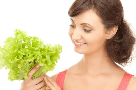 picture of happy woman with lettuce over white Stock Photo - 7885897