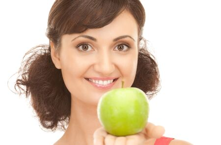 picture of young beautiful woman with green apple Stock Photo - 7885856