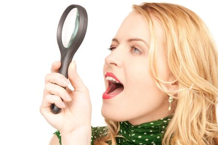 picture of woman with magnifying glass photo