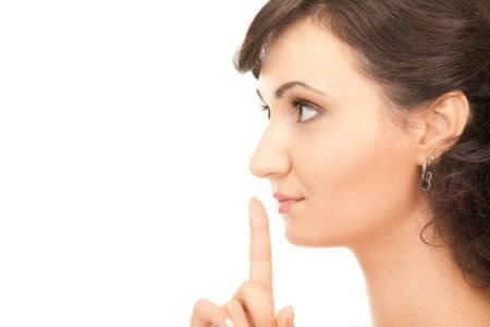 bright picture of young woman with finger on lips Stock Photo - 7886248