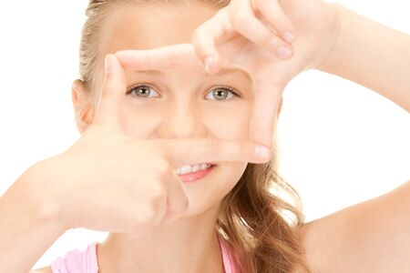 picture of pretty girl creating a frame with fingers photo