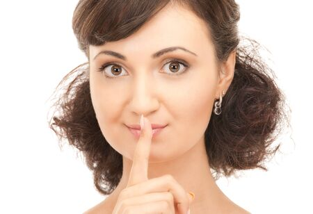 bright picture of young woman with finger on lips Stock Photo - 7886280