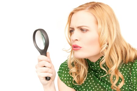 magnifier: picture of woman with magnifying glass over white