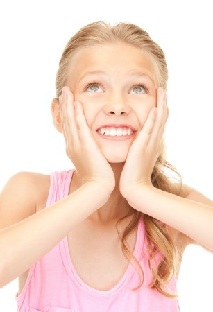 beautiful preteen girl: bright picture of surprised girl over white
