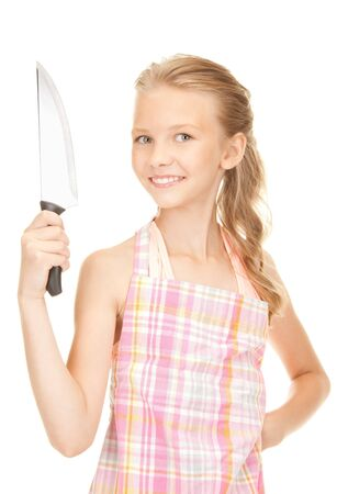 girl with knife: picture of little housewife with big knife Stock Photo