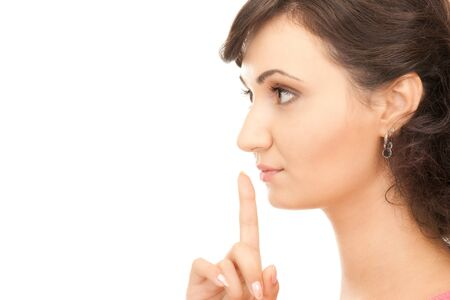 bright picture of young woman with finger on lips Stock Photo - 7886128
