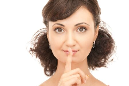bright picture of young woman with finger on lips Stock Photo - 7956716