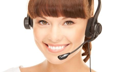 telephone headsets: imagen brillante del operador de la l�nea telef�nica femenino amistoso