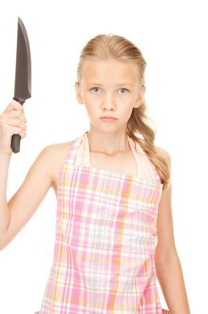 preteen girls: picture of little housewife with big knife Stock Photo