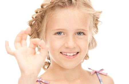 bright picture of lovely girl showing ok sign