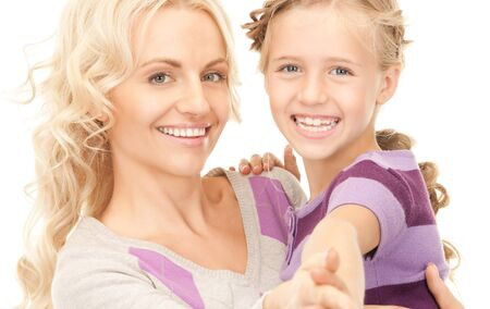 bright picture of happy mother and child (focus on woman) Stock Photo - 7956858
