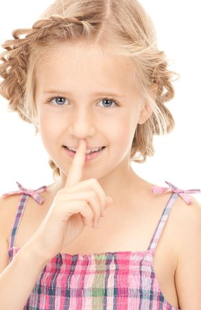 bright picture of pretty girl with finger on lips Stock Photo - 7956844