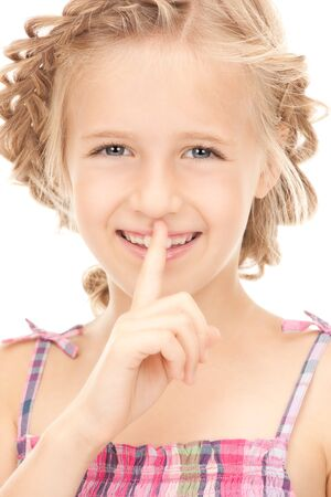 bright picture of pretty girl with finger on lips Stock Photo - 7956867